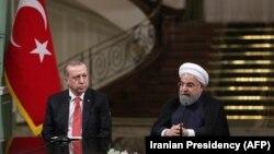 Presidenti iranian, Hassan Rohani dhe homologu rus, Recep Tayyip Erdogan.