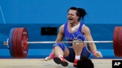 Svetlana Podobedova reacts after her final lift to win the gold medal in her group at the 2012 Summer Olympics in London.