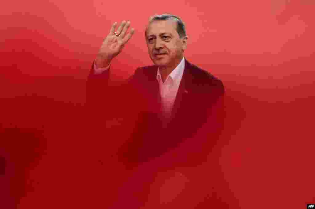 Turkish President Recep Tayyip Erdogan greets supporters during a rally on August 7 against a failed military coup last month. (AFP/Ozan Kose)