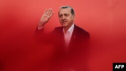 Turkish President Recep Tayyip Erdogan greets supporters during a rally against the failed July 15 military coup in Istanbul on August 7.