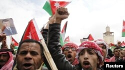Jordan -- Supporters of Jordan's King shout slogans during a demonstration in support of the King in Amman, 25Mar2011