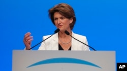 CEO of French gas and power group Engie Isabelle Kocher gestures as she speaks during the shareholder meeting of the group in Paris, France, Friday, May 18, 2018. (AP Photo/Michel Euler)