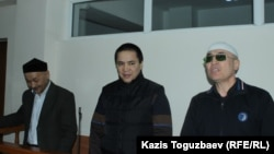 Kenzhebek Abishev, Oralbek Omyrov, and Almat Zhumagulov appear in court in October.