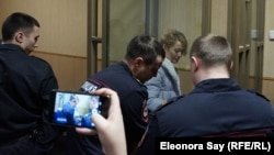 Anastasia Shevchenko is seen in the defendants' cage in a courtroom in Rostov-on-Don on January 23.