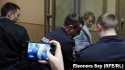 Anastasia Shevchenko is seen in the defendant's cage in a courtroom in Rostov-on-Don on January 23.