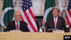 U.S. Secretary of State John Kerry (R) speaks with Pakistani Foreign Affairs Advisor Sartaj Aziz during at the US State Department in Washington, on February 29.