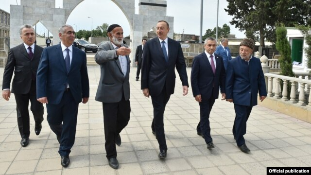 Azerbaijani President Ilham Aliyev (third from right) visited Nardaran in June, bringing gifts.