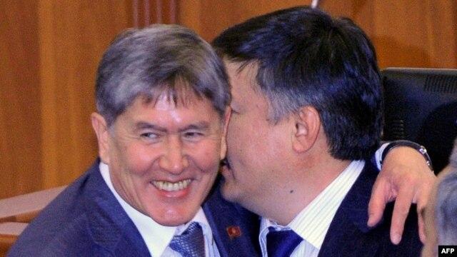 Newly elected prime minister of Kyrgyzstan, Almazbek Atambaev (L), is congratulated by the newly elected parliament speaker Akhmatbek Keldibekov.