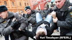 Police detain opposition activists near the closed entrance to Red Square