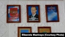 Сразу как входишь в школу, видишь портрет молодого Путина