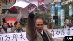"Demonstrators display banners and posters to support journalists from the ""Southern Weekly"" newspaper near the company's offices in Guangzhou, south Guangdong Province, on January 8."