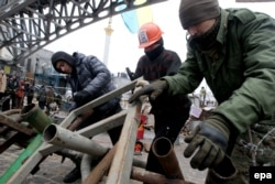 """""""Euromaidan"""" protesters set up a barricade in downtown Kyiv on December 13."""