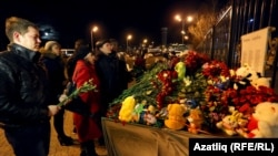 Mourners heaped flowers and other tributes to the victims of the air crash that killed 50 people at Kazan airport on November 17.