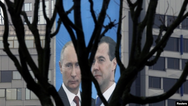 A campaign poster of Russian President Dmitry Medvedev (right) and Prime Minister Vladimir Putin appeals to people to vote for their political party, United Russia, in parliamentary elections in December.
