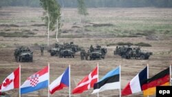 NATO soldiers conduct exercises in Zagan, Poland, on June 18.