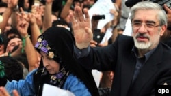Is Mir Hossein Musavi (right, with his wife Zahra Rahnavard) prepared to back down before the supreme leader's authority?