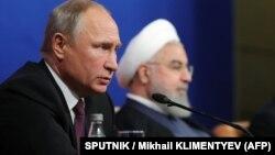 Оьрсийчоьнан президент Путин Владимир а (аьрру агIорхьара), ГIажарийчоьнан президент РоухIани Хьасан а. ТехIран, 2018