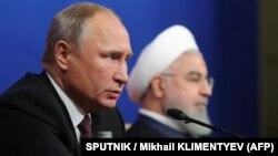 Владимир Путин и Хасан Роугани