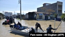 Residents of the northern Iranian village Agh Ghaleh are using a boat in a flooded street, on March 23, 2019.<br /> <br /> <br /> &nbsp;