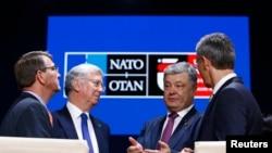 U.S. Defense Secretary Ash Carter, British Defense Secretary Michael Fallon, Ukrainian President Petro Poroshenko, and NATO Secretary-General Jens Stoltenberg in Warsaw