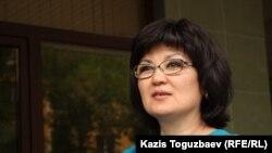 Мұхтар Зимановтың қоғамдық қорғаушысы әрі әйелі Жанат Зиманова. Алматы, 11 шілде 2013 жыл.
