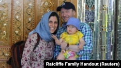 Iranian-British aid worker Nazanin Zaghari-Ratcliffe (left) poses with her husband, Richard Ratcliffe, and her daughter, Gabriella.
