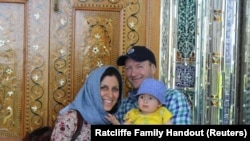 IRAN -- Iranian-British aid worker Nazanin Zaghari-Ratcliffe is seen with her husband Richard Ratcliffe and her daughter Gabriella, undated
