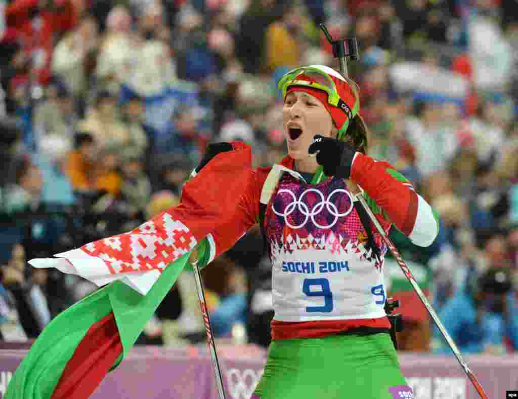Darya Domracheva of Belarus reacts after winning the gold medal during the women's 10 kilometer pursuit.