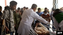 A wounded rebel fighter is wheeled into a hospital in Ajdabiya on April 7,