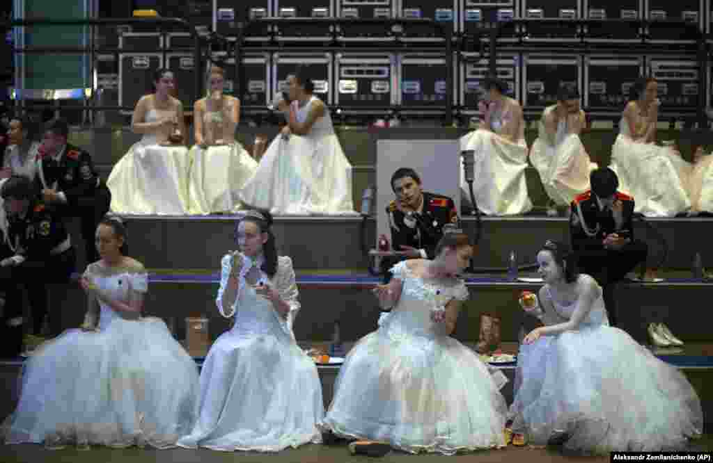 Participants in an annual ball for students of military schools sit backstage during the event in Moscow.  (AP/Aleksandr Zemlianichenko)