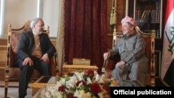 رئيس إقليم كردستان العراق مسعود بارزاني ومساعد سكرتير مجلس الأمن القومي الإيراني محمد رضا مقدمي