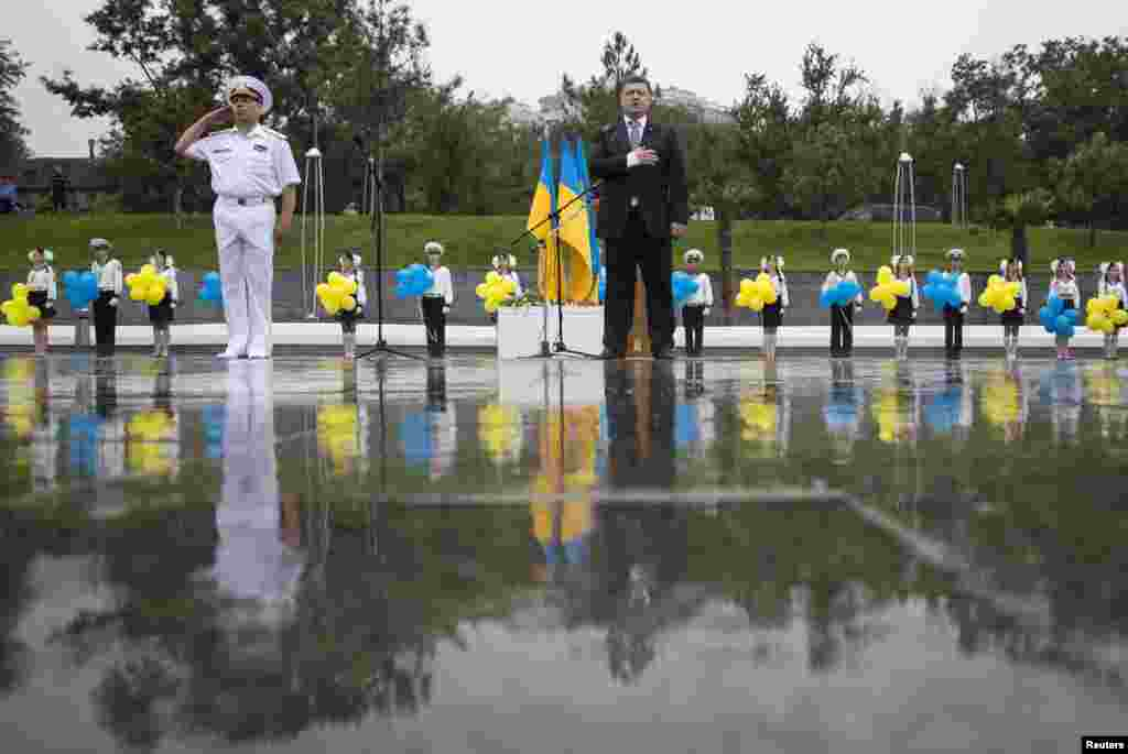 Ukrainian President Petro Poroshenko listens to the national anthem during Independence Day celebrations in the Black Sea port of Odesa on August 24. (Reuters/Mikhail Palinchak)