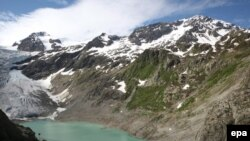 Switzerland -- Trift bridge over the Trift lake near the Trift Glacier in the Susten rock mass, 12Jun2009