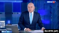 RUSSIA -- Dimtry Kiselyov, one of Russia's most powerful media figures, speaks during his Sunday news program on state-owned TV channel Rossia-1.