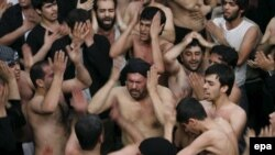 Iranians mourn during the Ashura ceremonies at the Karbala Mosque in Tehran in 2007.