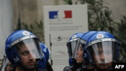 Turkish riot police stand guard in front of a French diplomatic facility in Istanbul as Turks rally after the French lower house approved a bill on December 22 to criminalize the denial of recognized genocides.