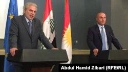 المفوض الأوروبي كريستوس ستايلياندس (يسار) ووزير التخطيط في حكومة اقليم كردستان علي السندي في أربيل