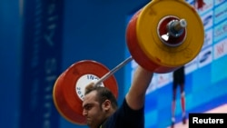 Iran's Behdad Salimikordasiabi set a record but was unable to complete a weightlifting competition in Rio, losing to Georgia's Talakhadze.