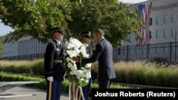 U.S. President Barack Obama places a wreath during a ceremony marking the 15th anniversary of the 9/11 attacks at the Pentagon in Washington, U.S., September 11, 2016.
