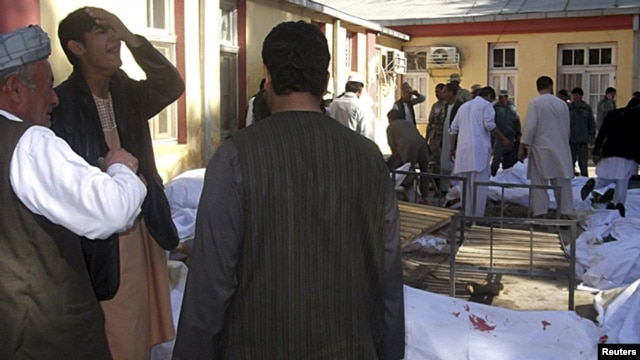 Relatives of victims cry at a local hospital after the bomb blast in Faryab Province.