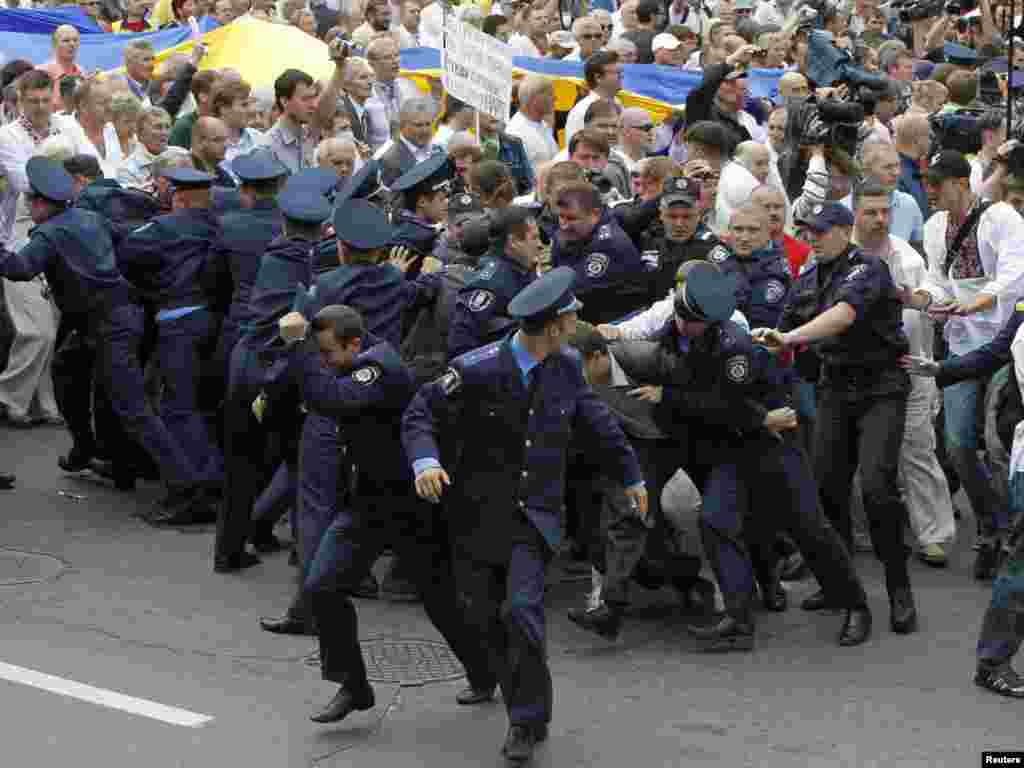 Policemen run as opposition supporters break their cordon during a rally on the 20th anniversary of Ukraine's Independence in Kyiv, on August 24. Photo by Gleb Garanich for Reuters