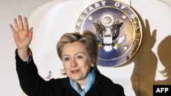 U.S. Secretary of State Hillary Clinton waves as she arrives on February 16 in Tokyo, the first stop of her Asian tour.