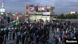 Antigovernment demonstrators protest in Amude, Syria, on December 27.