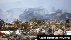Ilustrim, pamje të shkatërrimeve nga cunami i vitit 2011 që godit Japoninë