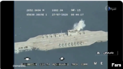 Iranian Cruise missile targeting the replica of a U.S. aircraft carrier in the Persian Gulf during military excercises dubbed as Great Prophet-14 (Payambar-e Azam 14). Screen grab from IRIB. July 28, 2020.