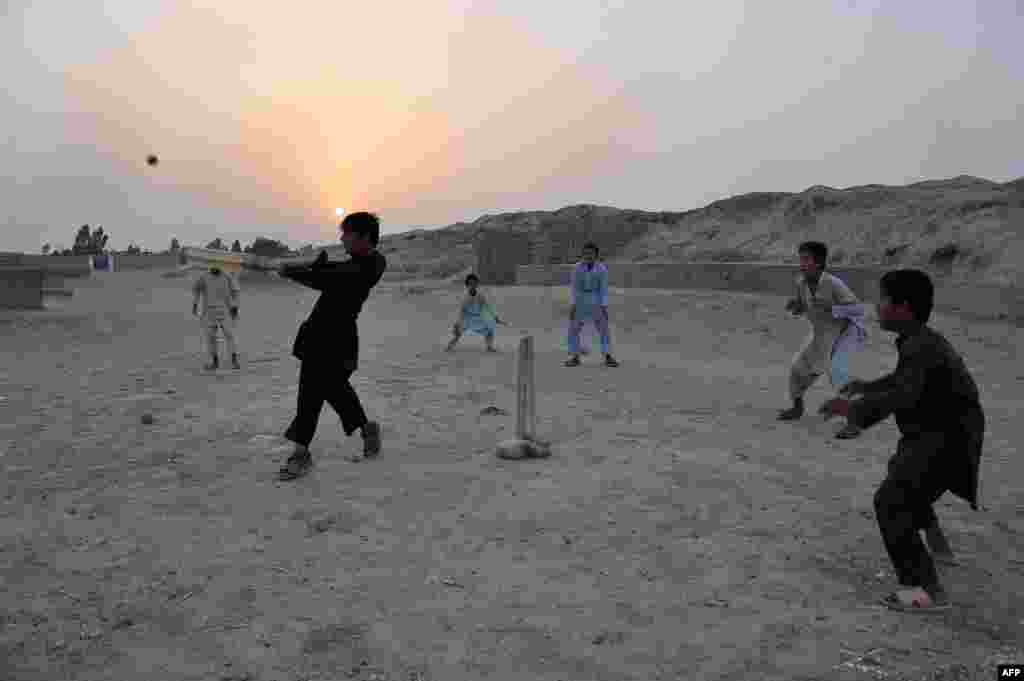 Boys play cricket at sunset on the outskirts of Jalalabad, Afghanistan. (AFP/Noorullah Shirzada)