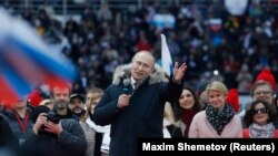 Russian President Vladimir Putin delivers a speech during a rally in Moscow on March 3.