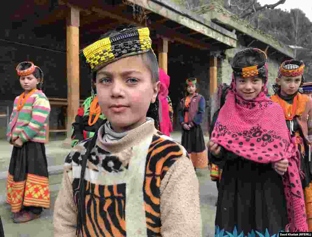 Kalash schoolgirls during morning assembly. Kalash children learn in mixed schools alongside the Muslim children of the surrounding villages. RFE/RL's Khattak said he watched Kalash children being taught Islamic scripture during lessons. There are currently no separate schools for Kalash children.