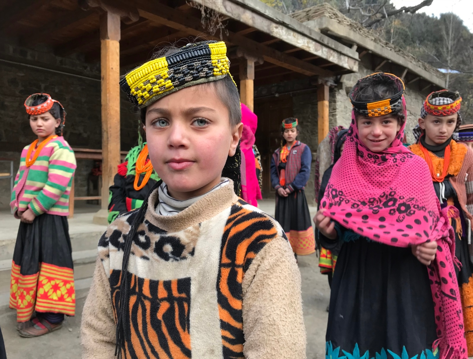 Kalash schoolgirls gathering during morning assembly. A Kalash lawmaker says he hopes lessons in Kalash culture and religion will be introduced in schools, an issue he intends to raise in the provincial legislature.