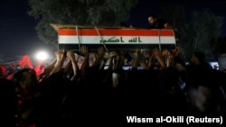 Men carry the coffin of a demonstrator who was killed during antigovernment protests in Baghdad on October 4.